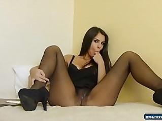 Teen in black pantyhose fingering pussy