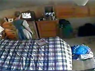 My mum rubbing her pussy watching porno. Hidden cam