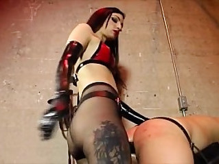 Mistress fucking slave with black dildo