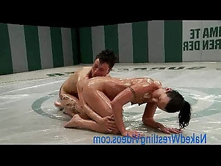 Strong lesbians wrestling oiled bodies