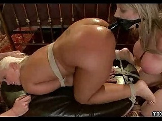 Two lesbians play anal with big rubber dick