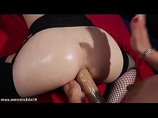 Brunette takes huge strap on up her ass